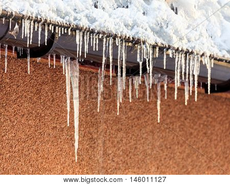 Icicles hanging down from roof