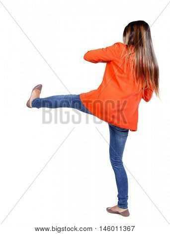 back view of woman funny fights waving his arms and legs. student in the red jacket has a foot.