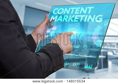 Internet. Business. Technology Concept. Businessman Presses A Button Content Marketing On The Virtua
