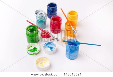 Paint In Glass Jars And Brushes