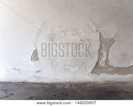 Damage caused by damp and moisture on a wall poster