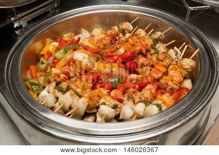 Bar-B-Q or BBQ with kebab cooking grill of chicken meat skewers with peppers