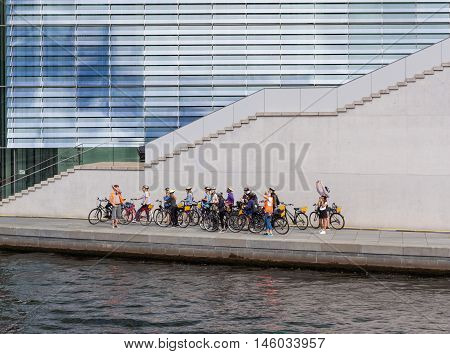 Group Of Young Tourists On A Bike Tour In Berlin