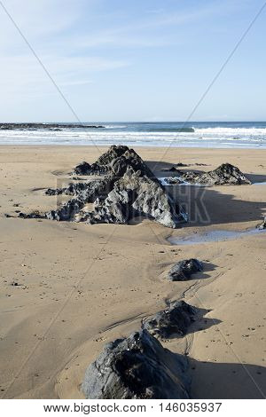 rock formations on sandy beach in Ballybunion Ireland
