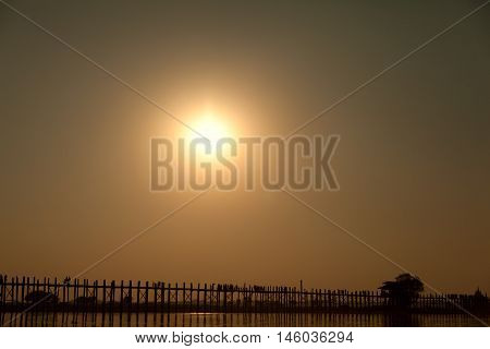 U Bein Bridge at sunset at Ayeyarwady River Mandalay Myanmar. Wide shot with copy space.