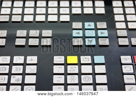 Close up of keypad of CNC control panel. Selective focus.