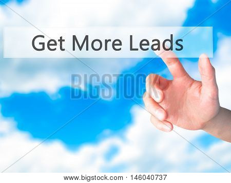 Get More Leads - Hand Pressing A Button On Blurred Background Concept On Visual Screen.