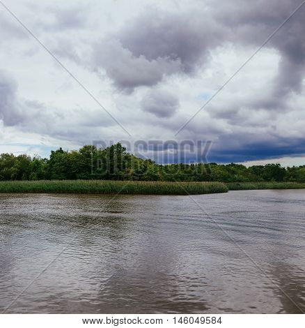 Thunderclouds Over The River In The Spring.