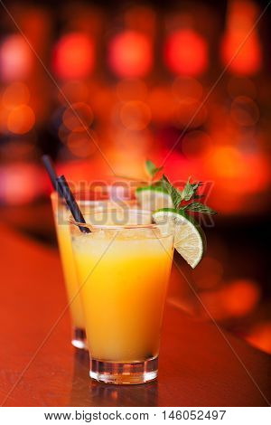 Harvey Wallbanger cocktails on a bar counter in a nightclub poster