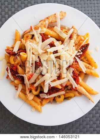 Pasta with chicken dried tomatoes and parmesan cheese