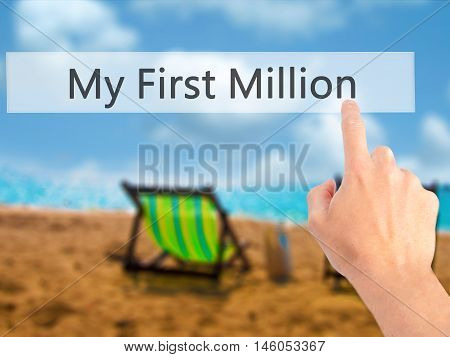 My First Million - Hand Pressing A Button On Blurred Background Concept On Visual Screen.
