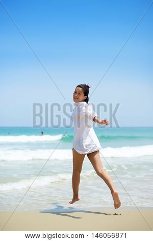 Asian Girl Running Toward Water