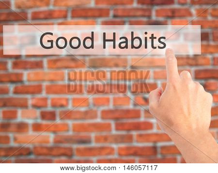 Good Habits - Hand Pressing A Button On Blurred Background Concept On Visual Screen.