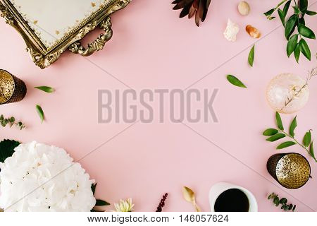 creative decorated and arranged flat lay frame concept with vintage tray hydrangea shells coffee golden spoon branches on pink background. top view