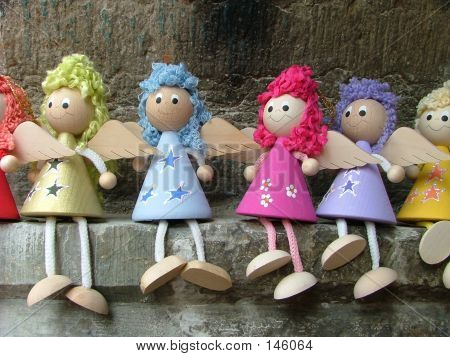 line of wooden doll angels poster