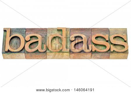 badass  - isolated word abstract in letterpress wood type printing blocks stained by color inks
