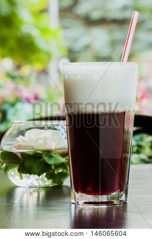 Summer, cafe , terrace, large glass cup of refreshing coffee glissade