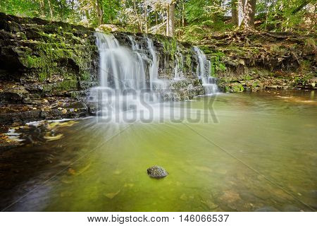 Ivande waterfall on small river in Renda Latvia