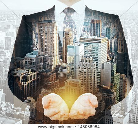 Businessman holding something in palms on abstract city background. Double exposure
