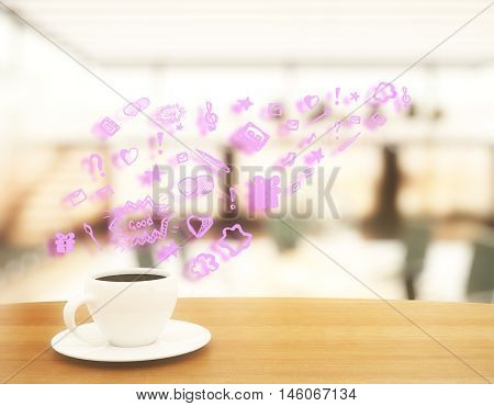 Wooden desktop with ceramic coffee cup on saucer and abstract pink communication icon on blurry background. Social media concept