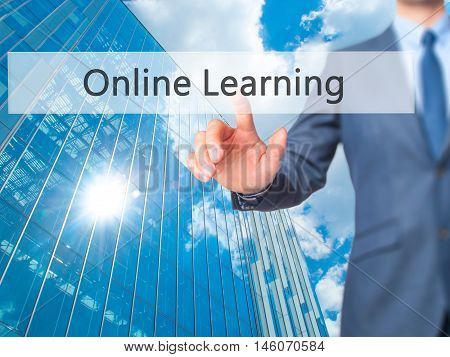 Online Learning - Businessman Hand Pressing Button On Touch Screen Interface.