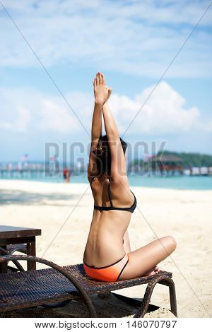 Asian Girl Doing Yoga On A Recliner Chair