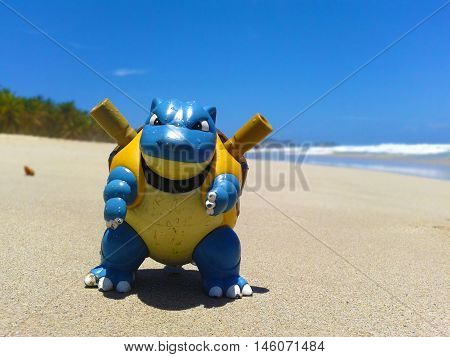 Nueva Esparta, Venezuela 07 september 2016. little toy of  the caracter blastoise from the anime pokemon on the beach sand looking like a real wild pokemon