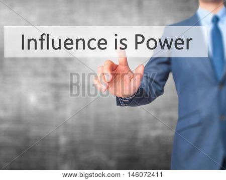 Influence Is Power - Businessman Hand Pressing Button On Touch Screen Interface.