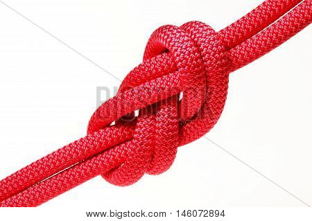 big red rope knot on white background