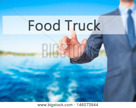 Food Truck - Businessman Hand Pressing Button On Touch Screen Interface.