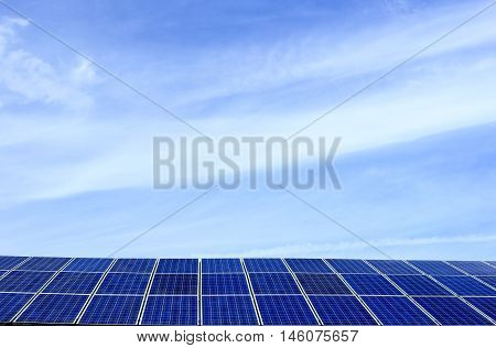 many blue photovoltaic cells on a roof
