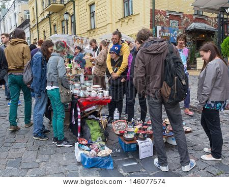 Kiev Ukraine - August 24 2016: Youth sells pottery on the street St. Andrew's descent - the historical center of Kiev