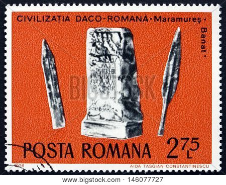 ROMANIA - CIRCA 1976: a stamp printed in Romania shows Sword Lance and Tombstone Daco-Roman Archaeological Treasure circa 1976