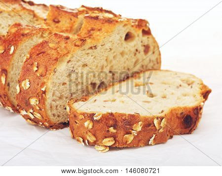 sliced wholegrain bread with oats and nuts, on paper