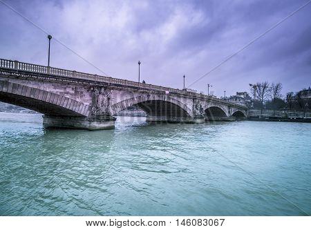 Bridge Austerlitz over river Seine in Paris - Beautiful architecture the Bridge Austerlitz crossing over the river Seine from Paris France in a rainy day