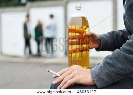 Close Up Of Teenager Drinking Alcohol And Smoking