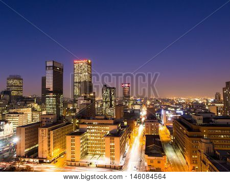 JOHANNESBURG SOUTH AFRICA - JUNE 15 2016: Johannesburg cityscape by night as seen from the roof of one of the buildings in the business district.
