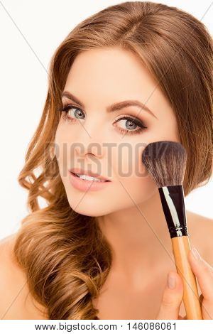 Portrait Of Cute Beautiful Girl Doing Maquillage With Makeup Brush