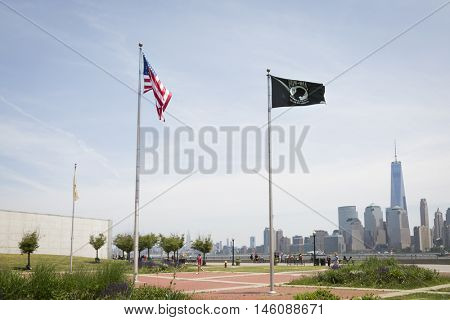 JERSEY CITY NJ MAY 29 2016: The American Flag and POW/MIA Flag at Liberty State Park with the New York City skyline in the background seen during Fleet Week 2016.