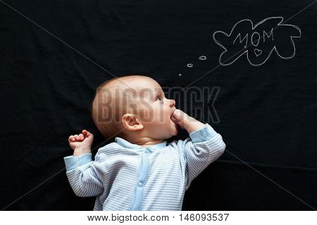 Baby newborn thinking about his mother on black background