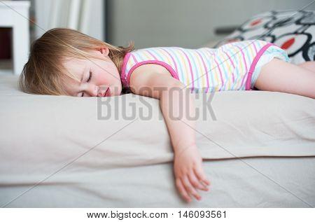 Sick Baby Girl Lying In Bed