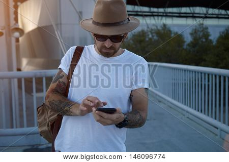Tourist In The City With Smartphone