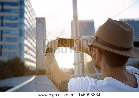 Taking A Photo Of  City At Sunset