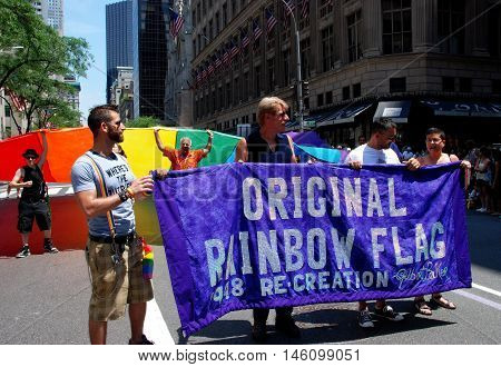 New York City - June 30 2007: Marchers with their banner for the Original Rainbow Flag at the 2007 Gay Pride Parade on Fifth Avenue