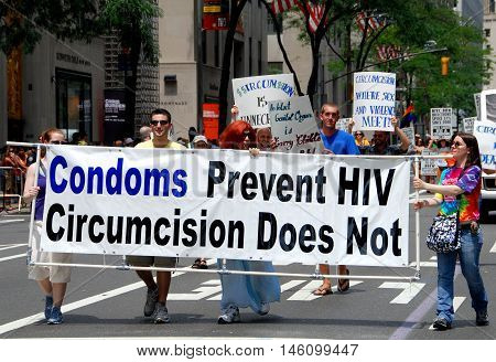 New York City - June 30 2007: Anti-circumcision marchers with their banner at the 2007 Gay Pride Parade on Fifth Avenue
