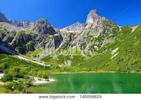 Beautiful summer landscape. Mountain lake Zelene pleso in National Park High Tatra. Slovakia, Europe.