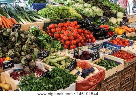 Beautiful showcase with vegetables on the market. Fresh and juicy