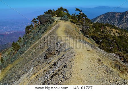 Hiking Trail on a mountain ridge with views of the Southern California landscape taken at Mt Baldy, CA