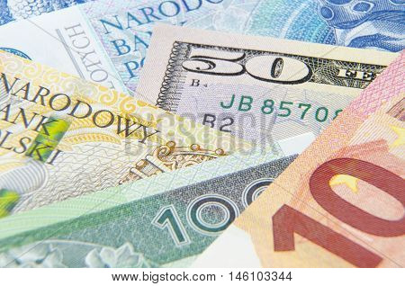Background with money american dollar polish zloty european euro; Macro photo