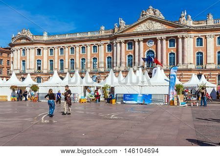 Toulouse, France - April 1, 2011: French People Walking At Square Near Capitole